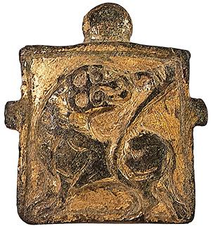 Finimento in bronzo dorato.  Italia, XI secolo.