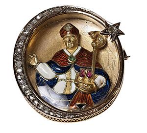 Un San Gennaro principesco.  Spilla in oro, diamanti, pietre preziose e smalti con le insegne dell'Ordine di San Gennaro.