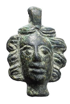Lot 157 - Bronze human head pendant  Roman, Balkan region, 2