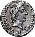 obverse: Augustus (27 BC. - 14 AD.).  AR Denarius. M. Durmius moneyer, 18 BC. Obv. M. DVRMIVS III VIR HONORI. Head of Augustus as Honoros right. Rev. AVGVSTVS above, [CAESAR below] Augustus standing in elephant-biga left, holding laurel and sceptre. RIC 331. AR. g. 4.04  mm. 19.00  RR.  EF/Good EF. Very rare and superb. Enchanting light iridescent tone.