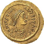 obverse: Ostrogothic Italy, Baduila (541-552).  AV Tremissis, in the name of Justinian I. Ticinum mint. Obv. DN IVSTINIANVS PP ΛVC. Pearl-diademed, draped and cuirassed bust right. Rev. VICTORΛ ΛVGVSTORVI. Victory advancing right, head left, holding wreath and globus cruciger; star to right, pellet at each end of ground line; in exergue, CONOB. Cf. MIB 33 var. Cf. MEC 1 var. AV. g. 1.47  mm. 16.00  RR.  About EF/EF. An outstanding example of this very rare issue.