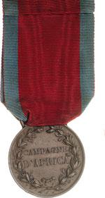 reverse:  Umberto I (1878-1900) Medaglia delle campagne d Africa. Istituita il 3 novembre 1894. Nastro rosso bordato di azzurro.