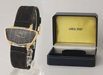 """obverse: BUECHE GIROD, """"Lancia radiator"""", around 1970. Case in 18 k yellow gold, shape of Lancia car radiator"""