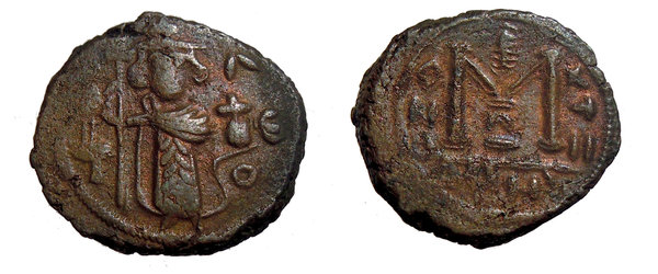 D/ Islamic, Umayyad Caliphate. Standing caliph type, c. 680s. Æ Fals (19mm, 4.30g, 6h). Dimashq, mint name in Greek. Emperor standing facing, holding long cross and globus cruciger; palm leaf above T to l. R/ Anchor above large M; downward crescent below. Album 3517.1. Rare, VF