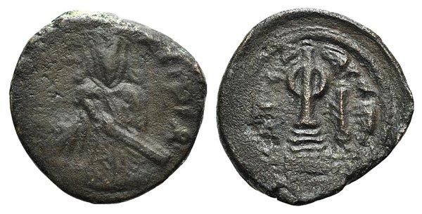 D/ Islamic, Umayyad Caliphate. 'Abd al-Malik ibn Marwan (AH 65-86 / AD 685-705). Æ Fals (16mm, 2.81g, 6h). Halab (Aleppo). Standing Caliph holding a sword in scabbard. R/ Circle on steps. Album 3529. VF