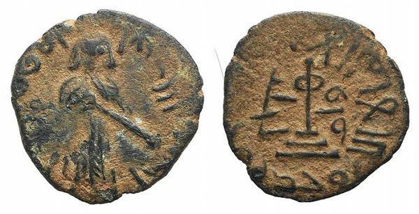 D/ Islamic, Umayyad Caliphate. 'Abd al-Malik ibn Marwan (AH 65-86 / AD 685-705). Æ Fals (19mm, 2.50g, 11h). Halab (Aleppo), 690s. Caliph standing facing, hand on pommel of sword. R/ Transformed cross on steps. Album 3529. Earthy-brown patina, VF