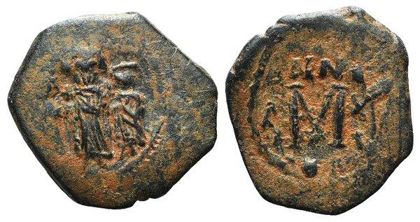 D/ Arab-Byzantine, c. 660s-680s. Æ Fals (25mm, 5.02g, 7h), Three standing imperial figures, each holding globus cruciger. R/ Large M. Cf. Album 3501. Brown patina, VF