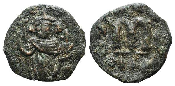 D/ Arab-Byzantine, c. 660s-680s. Æ Fals (22mm, 3.39g, 6h), Emperor standing facing, holding long cross and globus cruciger. R/ Cursive M. Cf. Album 3504. Green-brown patina, VF