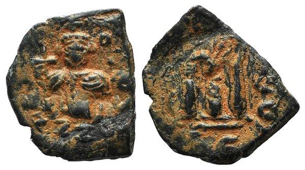 D/ Arab-Byzantine, c. 660s-680s. Æ Fals (23mm, 3.28g, 7h), Emperor standing facing, holding long cross and globus cruciger. R/ Cursive M. Cf. Album 3504. Brown patina, near VF