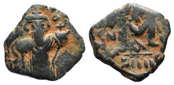D/ Arab-Byzantine, c. 660s-680s. Æ Fals (19mm, 2.29g, 6h), Emperor standing facing, holding long cross and globus cruciger. R/ Large M; star above. Cf. Album 3504. Brown patina, near VF