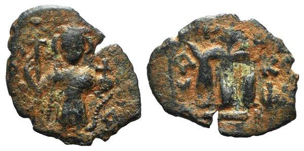 D/ Arab-Byzantine, c. 660s-680s. Æ Fals (22mm, 3.39g, 6h), Emperor standing facing, holding long cross and globus cruciger. R/ Cursive M; AN[…] to l.; XI to r. Cf. Album 3504. Green-brown patina, VF