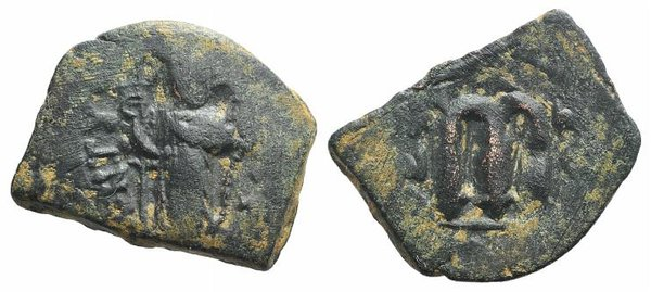 D/ Arab-Byzantine, c. 7th century. Æ Fals (23mm, 4.38g, 6h). Uncertain mint, c. 658-664. Emperor standing facing, holding long cross and globus cruciger. R/ Cursive m. Cf. Album 3504. Green patina, near VF