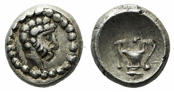 D/ Cilicia(?). Fake Hemiobol (5mm, 0.30g, 12h). Bearded head r. R/ Kantharos. Modern fake for study