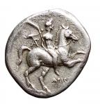 D/ Mondo Greco - Calabria. Tarentum. 235-228 a.C. Nomos. D/ Efebo con ramo di palma e ghirlanda a cavallo a destra. R/ Taras con kantharos su delfino. Vlasto 948. Peso gr. 5,42. BB++.
