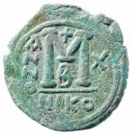 R/ Bizantini. Giustino II. 565-578 d.C. Follis. AE. Nicomedia. D/ Giustino e Sofia seduti di fronte su doppio trono. R/ ANNO III. Grande M. Sotto B. In esergo: NIKO. D.O. 92. Peso 13,85 gr. Diametro 26,50 mm. BB+.po