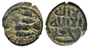 D/ Umayyad, Post reform period without mint names. Æ Fals (18mm, 3.60g, 11h). Uncertain Palestinian mint. Bird flying l. R/ Legend in three lines. SNA Tübingen IVa 535 Walker 590. Rare. Green patina, VF
