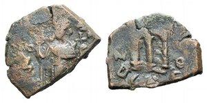 D/ Islamic, Arab-Byzantine, imitating Constans II, after AD 641. Æ Fals (23mm, 3.83g, 1h). Emperor standing facing, holding cruciform sceptre and globus cruciger. R/ Large m; cross above. Cf. SICA 1, p. 89. Good Fine