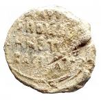 R/ Bizantini - Sigillo in piombo. D/ San Michele ?. R/ Legenda su 4 righe. Peso gr. 4,51. Diametro mm 17,4. Buona conservazione e bella patina.