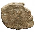D/ Bizantini- Sigillo in Piombo. D/ Busto frontale. R/ Tre figure in piedi stanti.Pesogr 18,3. Diametromm max 34,6. Patina.R.