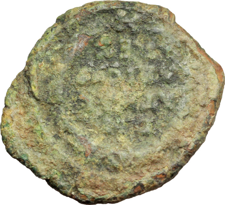 R/ Ostrogothic Italy, Athalaric (526-534).  AE Decanummium, 527-534 AD. Ravenna mint. Obv. INVICTA ROMA. Helmeted and cuirassed bust of Roma right. Rev. D N/ATHAL/ARICVS/REX in four lines; all within wreath. Ranieri 583-84. MIB 77-8. MEC 1, 133-4. AE. g. 3.56  mm. 20.50  RR. Rare. Uncleaned deposits. F.