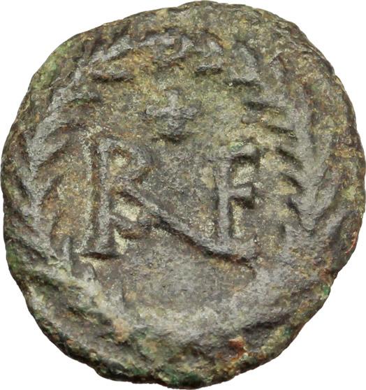 R/ Ostrogothic Italy.  AE Decanummium. Municipal bronze coinage of Ravenna, circa 536-554 AD. Obv. FELIX RAVENNA. Crowned bust of Ravenna right. Rev. Monogram of Ravenna. MEC 145-149. Ranieri 260-269. AE. g. 2.47  mm. 16.50  R.  About VF/VF.