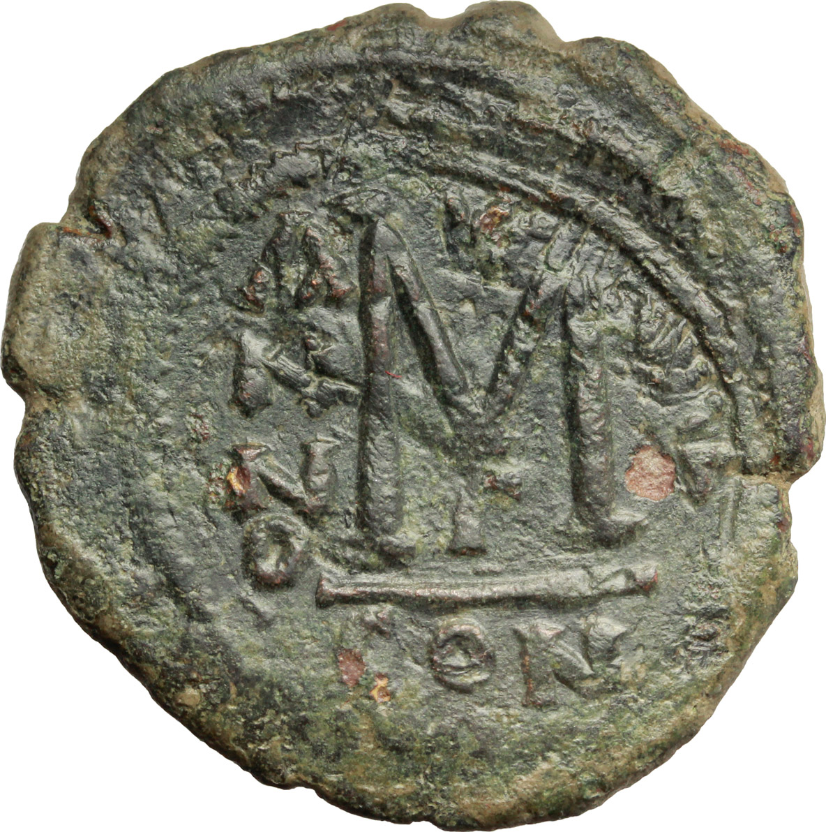 R/ Heraclius, with Heraclius Constantine (610-641).  AE Follis, Constantinople mint. Countermarked. Obv. dd NN hERACLIЧS ET hERA CONST PP A. Heraclius, on left, and Heraclius Constantine, on right, standing facing, each holding long cross; cross above. Rev. Large M; Christogram above, A/N/N/O- [...] across field; below, Γ; in exergue, CON. Sear 805. AE. g. 11.85  mm. 33.50   A nice example. Earthy green patina. Good VF.