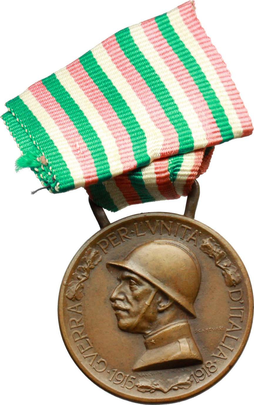 D/ Vittorio Emanuele III (1900-1943). Medaglia commemorativa della guerra 1915-1918 e nastrino tricolore.     AE.   mm. 32.50    Bel BB.