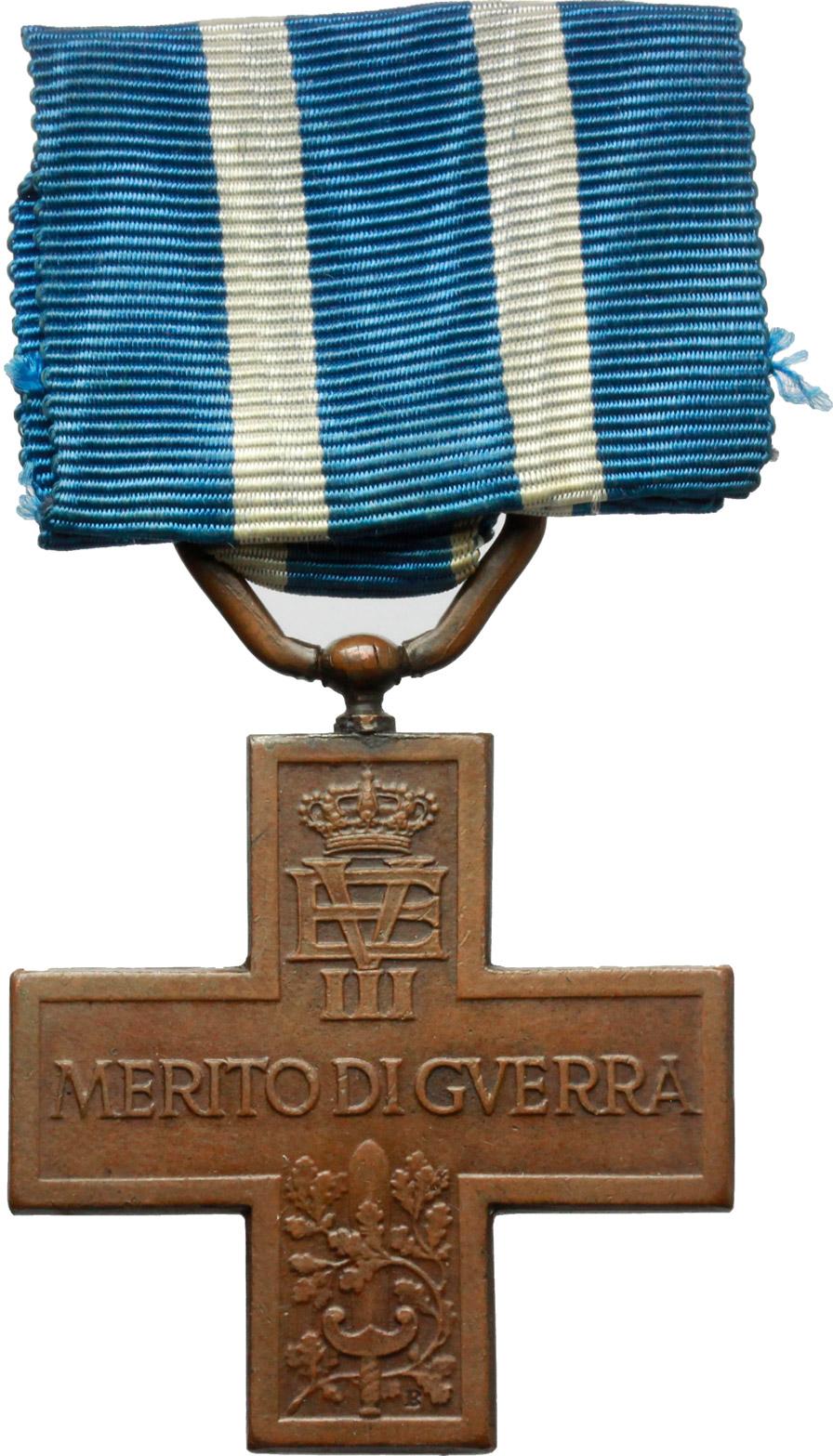 D/ Vittorio Emanuele III (1900-1943). Medaglia a croce con nastrino, al merito di guerra. (1922).    Brambilla p. 618. AE.     Dimensioni: 38 x 38 mm. SPL.