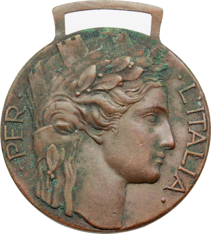 D/  Distintivo d'onore  per  gli ex irredenti italiani volontari della guerra MCMXV-MCMXVIII.    Brambilla p. 866. AE.   mm. 32.00 Inc. Morbiducci.  Ossidazioni. Bel BB.