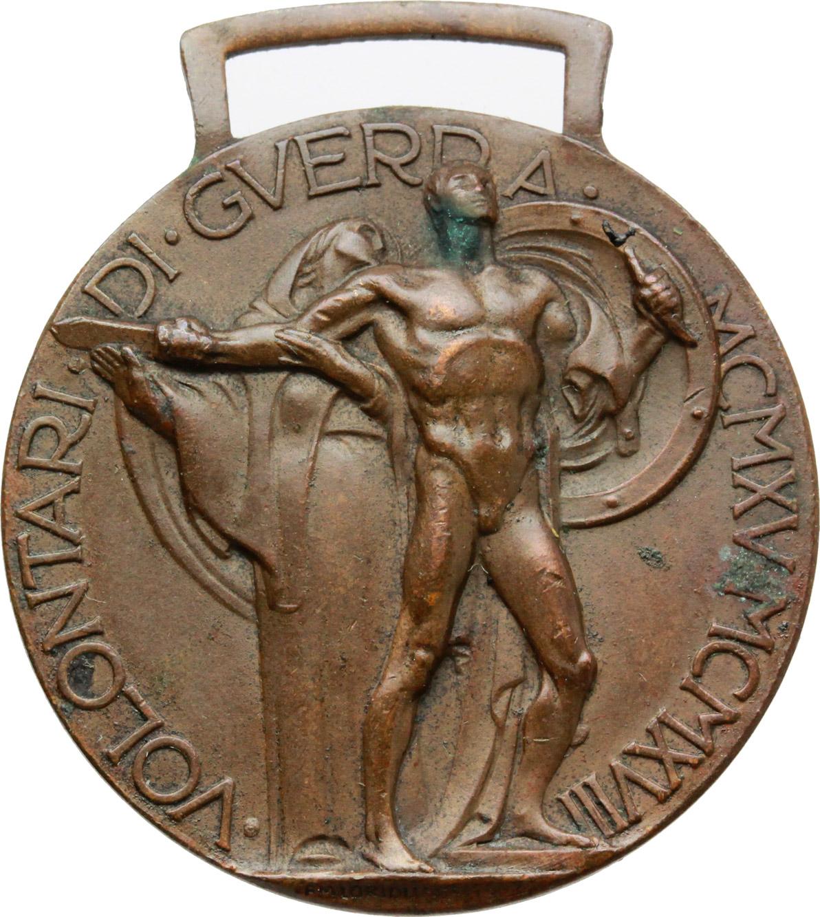 R/  Distintivo d'onore  per  gli ex irredenti italiani volontari della guerra MCMXV-MCMXVIII.    Brambilla p. 866. AE.   mm. 32.00 Inc. Morbiducci.  Ossidazioni. Bel BB.