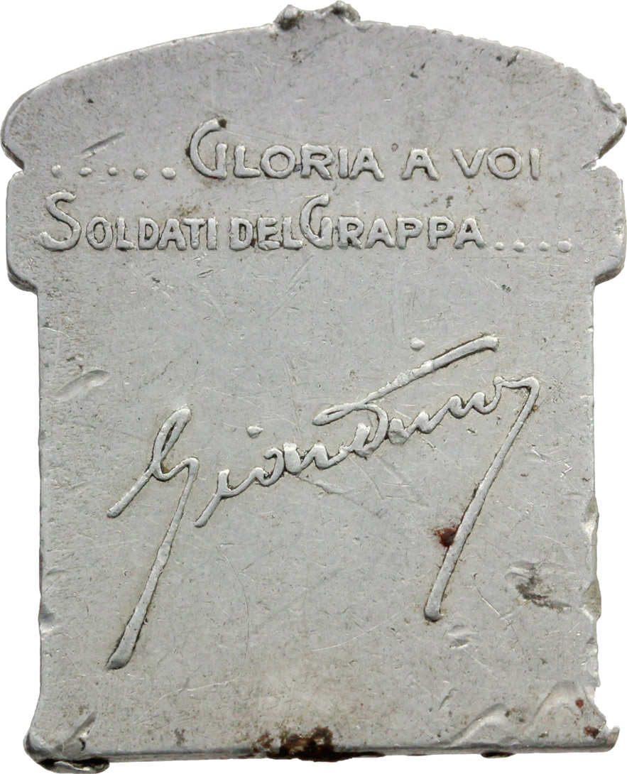 R/ Alpini. Medaglietta Armata del Grappa, nov. 1917- nov 1918.     MB.     Dimensioni: 31 x 25 mm.  Appiccagnolo rimosso. BB.