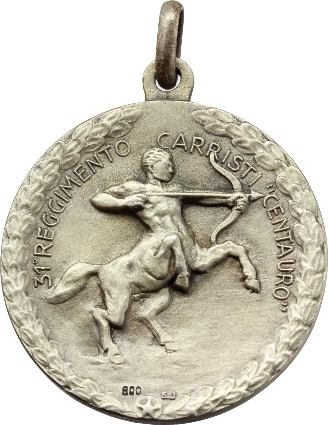 R/  Medaglia con appiccagnolo 31° Reggimento carristi 'Centauro'. 'Ferrea mole/ ferreo cuore'.     AG.   mm. 30.00    SPL.