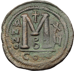 R/ Justinian I (527-565).  AE Follis, Constantinople mint. Obv. DN IVSTINIANVS PP AVI. Helmeted and cuirassed bust facing, holding globus cruciger and shield; to right, cross. Rev. Large M between A/N/N/O and X/Y; above, cross; below, B; in exergue, CON. D.O. 37-61. Sear 163. AE. g. 21.91  mm. 39.00    Good VF. Leather brown patina.