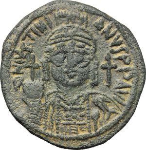 D/ Justinian I. (527-565).  AE Follis, Cyzicus mint. Obv. DN IVSTINIANVS PP AVI. Helmeted and cuirassed bust facing, holding globus cruciger and shield; to right, cross. Rev. Large M between A/N/N/O and X/X/II/II; above, cross; beneath, B; in exergue, KIZ. D.O. 164-81. Sear 207. AE. g. 16.92  mm. 34.00   A very attractive example. Roughness. Dark green patina. About EF.