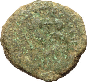 D/ Justin II and Sofia (565-578).  AE Follis, Carthage mint. Obv. [DN IVSTINO] ET SOFIE. Justin and Sofia seated facing. Cross between their heads. Rev. Large M; above, large X with stars above and beneath; to left, A/N/N/O; to right, K/A/R. D.O. 202. R. 908. Sear 394. AE. g. 26.52  mm. 30.00  RR. Minor metal flaw in R/ and marginal die-weakness. F/Good VF. Very rare. Green patina.