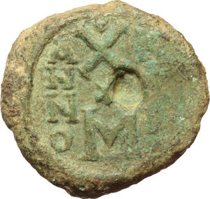 R/ Justin II and Sofia (565-578).  AE Follis, Carthage mint. Obv. [DN IVSTINO] ET SOFIE. Justin and Sofia seated facing. Cross between their heads. Rev. Large M; above, large X with stars above and beneath; to left, A/N/N/O; to right, K/A/R. D.O. 202. R. 908. Sear 394. AE. g. 26.52  mm. 30.00  RR. Minor metal flaw in R/ and marginal die-weakness. F/Good VF. Very rare. Green patina.