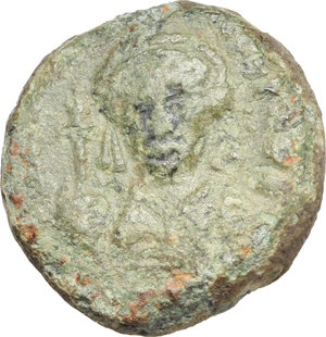 D/ Maurice Tiberius (582-602).  AE 10 Nummi, year 1 (582-583 AD), Catania mint. Obv. Crowned and cuirassed bust facing, holding globus cruciger and shield. Rev. Large I, between A/N/N/O and I; in exergue, CAT. DOC 264. Sear 580. AE. g. 4.44  mm. 15.50    VF.