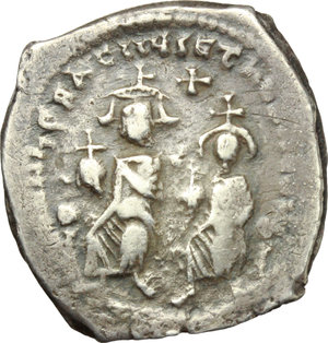 D/ Heraclius (610-641).  AR Hexagram, Constantinople mint. Obv. Heraclius and Heraclius Constantine seated facing on double throne; between their heads, cross. Rev. Cross potent on globe above three steps; in field to right, K. D.O. 64. Sear 798. AR. g. 6.25  mm. 25.50    VF.