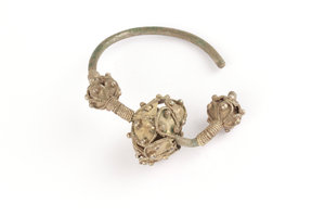 D/  Byzantine silver earring with three open-work spheres enhanced with beading. IX-XII century AD. Silver and gold gilt. 63 mm.