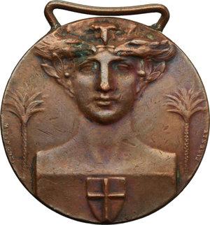 D/  Medaglia con appiccagnolo per gli Eroi della Conquista della Libia.     AE.   mm. 35.00 Inc. Zingoni.   BB.
