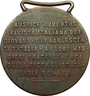 R/  Medaglia con appiccagnolo per gli Eroi della Conquista della Libia.     AE.   mm. 35.00 Inc. Zingoni.   BB.