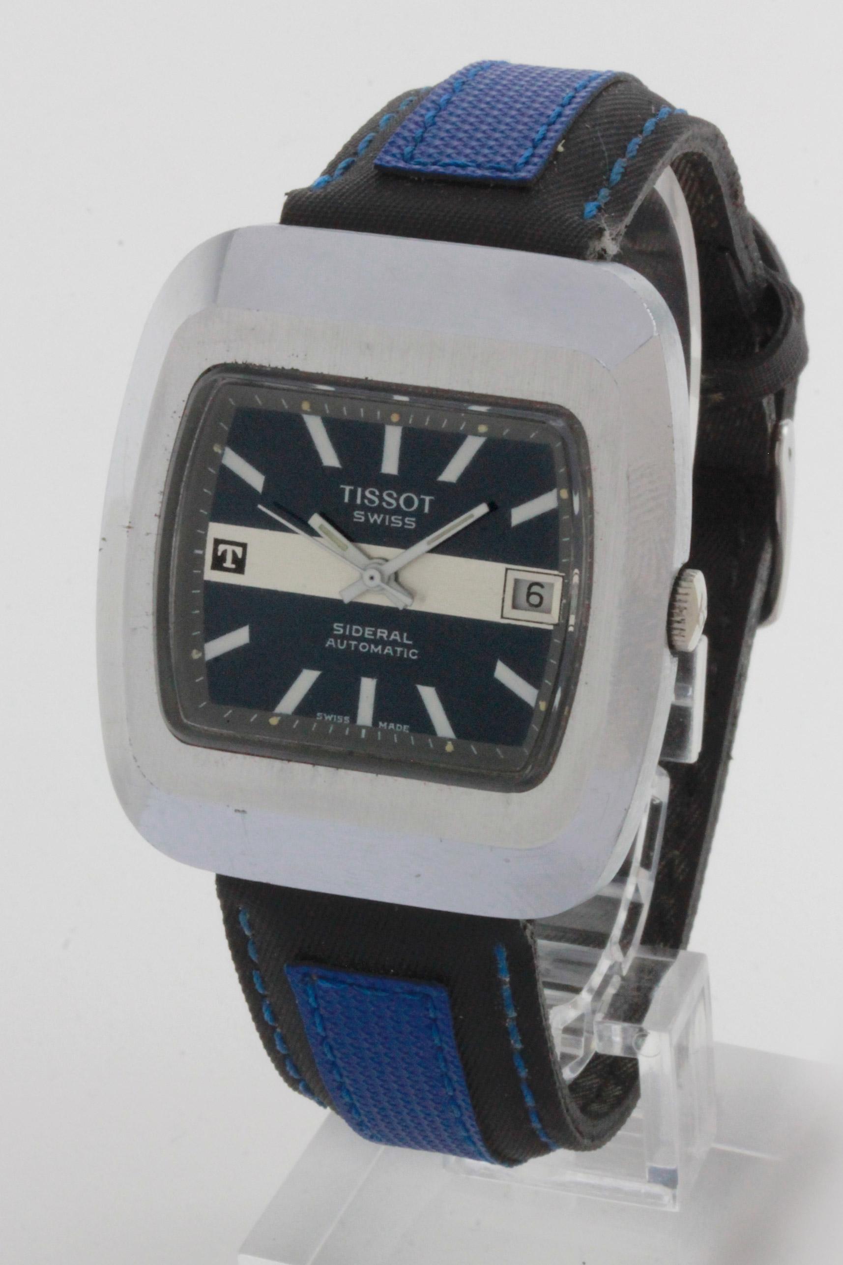 D/ Tissot Sideral carica automatica, anni '70, 37 x 41 mm. Tissot Sideral carica automatica, anni '70. Cassa fiberglass acciaio chiusa con baionetta. Vetro plexiglass, quadrante blu con fascia argent&eacute