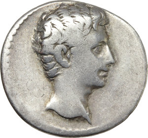 D/ Augustus (27 BC - 14 AD).  AR Denarius, Colonia Patricia mint (?), struck c. 20-19 BC. Obv. Bare head of Augustus right. Rev. IOVI/VOT SVSC/PRO SAL/CAES AVG/ SPQR in five lines within oak-wreath. RIC 57. BMC 430. AR. g. 3.52  mm. 20.00  RRR. Extremely rare. Lightly toned with iridescent hues. F/About VF. For dating of this issue, see RIC I, 57, note.