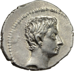 D/ Augustus (27 BC - 14 AD).  AR Denarius, Spanish mint (Emerita?). Obv. Bare head right. Rev. AVGVSTVS. Capricorn right, holding globe attached to rudder between front hooves; above, cornucopiae. RIC 126. C. 21. AR. g. 3.92  mm. 19.50  R. An outstanding example of this rare and fascinating issue. Brilliant and superb, virtually as struck. Good EF.