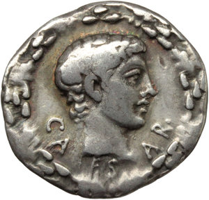 D/ Caius Caesar (died 4 AD).  AR Denarius, c. 17 BC. Obv. CA-ES-AR. Bare, youthful head (Caius Caesar?) right within oak wreath. Rev. AVG-VST divided by candelabrum ornamented with rams' heads; all within wreath entwined with bucrania and paterae. RIC 540 (Augustus). RSC 2. AR. g. 3.79  mm. 18.00  RR. A pleasant example of this very rare issue. Superb iridescent old cabinet tone. VF/Good VF. Caius, son of Agrippa and Julia, born in B.C. 20, was adopted by Augustus and given the name of Caesar. He was wounded during a battle in Armenia in A.D. 3 and died the following year. (D.R. Sear, RSC, p. 161).