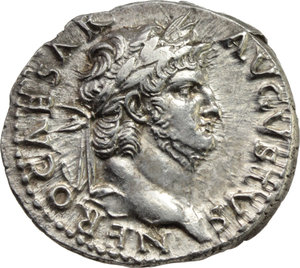 D/ Nero (54-68).  AR Denarius, Rome mint, struck c. 65-66 AD. Obv. NERO CAESAR AVGVSTVS. Laureate head right. Rev. VESTA. Hexastyle temple faςade; within, Vesta seated left on throne, holding patera and long sceptre. RIC 62. AR. g. 3.48  mm. 19.00  R. An outstanding example, perfectly centred on unusually broad flan. Great metal, with underlying luster. From fresh, exceptionally detailed and masterly engraved dies. Very rare in this amazing condition. Good EF/About FDC.