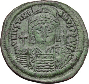 D/ Justinian I (527-565).  AE Follis, Constantinople mint. Obv. DN IVSTINIANVS PP AVG. Helmeted and cuirassed bust facing, holding globus cruciger and shield; to right, cross. Rev. Large M between A/N/N/O and X/III; above, cross and below, Δ. In exergue, CON. D.O. 37-61. Sear 163. AE. g. 23.13  mm. 41.00   An attractive example, struck on a broad flan. Dark emerald-green patina. Good VF.