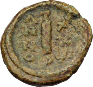R/ Justinian I (527-565).  AE Decanummium, Perugia mint (?). Obv. DN IVSTINIA [ ]. Diademed, draped and cuirassed bust left. Rev. Large I, surmounted by cross, between A/N/N/O and X/X/VI; below, P. MIB 101 (Constantinople) var. (bust right). D.O. - . T - . R - . Sear 328 B (Claude Held Coll.). AE. g. 18.50  mm. 18.50  RRR. Extremely rare. Green brown patina. VF.