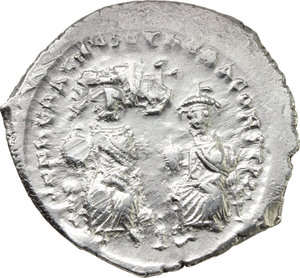 D/ Heraclius (610-641).  AR Hexagram or Double Miliarense, Constantinople mint. Obv. DD NON HERACLIVS ET HERA CONST PP. Heraclius and Heraclius Constantine seated facing on double throne, both holding globus cruciger; above, cross. Rev. DEVS ADIVTA ROMANIS. Cross potent on globe set on three steps. D.O. 61. R. 1389. Sear 795. AR. g. 6.60  mm. 26.00  R. Rare. Brilliant and superb. EF.