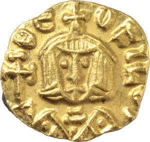 R/ Theophilus (829-842).  AV Tremissis, Syracuse mint. Obv. ΘEO-FILOS. Bust facing with short beard, wearing crown and chlamys, and holding globus cruciger. Rev. ΘE-OFILOS. Bust facing with short beard, wearing crown and loros, and holding cross potent. D.O. 27. T. 16-17. Sear 1678. AV. g. 0.98  mm. 10.00   A superb example. Good EF.